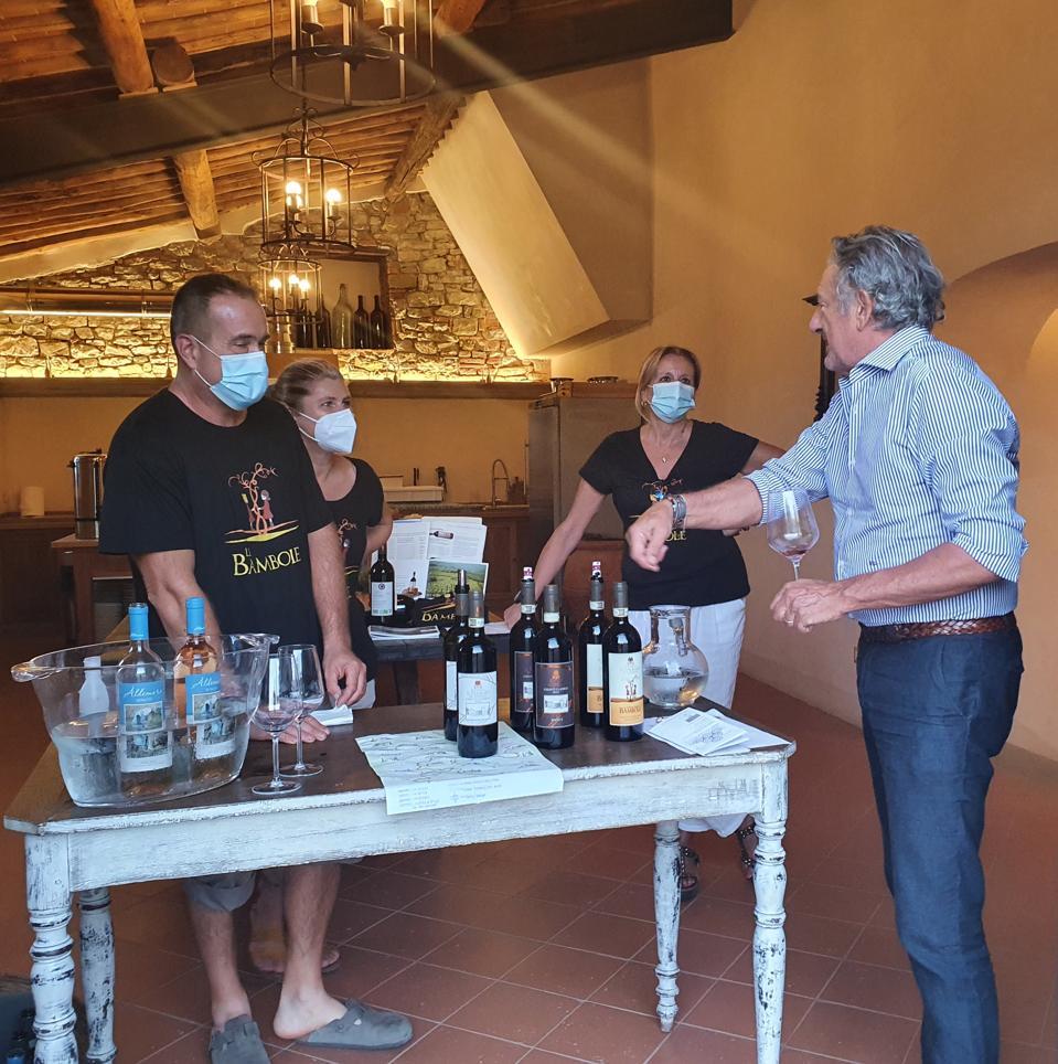 winemakers and wine tasters wear masks in Italy at festival Vino Al Vino Panzano Chianti