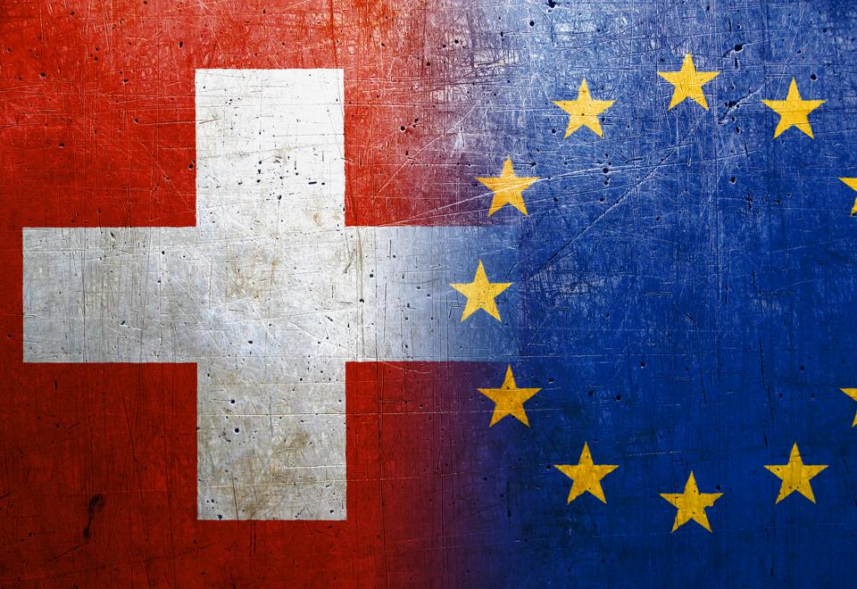 Switzerland and European Union flags on the grunge metal background