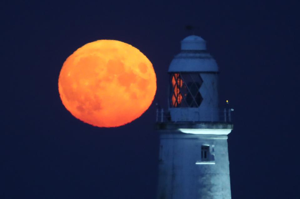 Last month's full 'Corn Moon' rising behind St Mary's Lighthouse in Whitley Bay, UK.