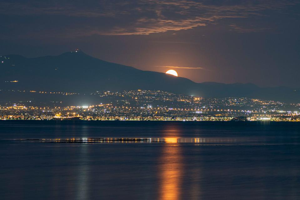 A full Moon rising behind Hortiatis mountain, Thessaloniki, northern Greece.