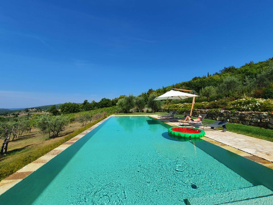 Swimming pool at the farmhouse winery villa of Renzo Marinai in Panzano in Chianti Tuscany Italy