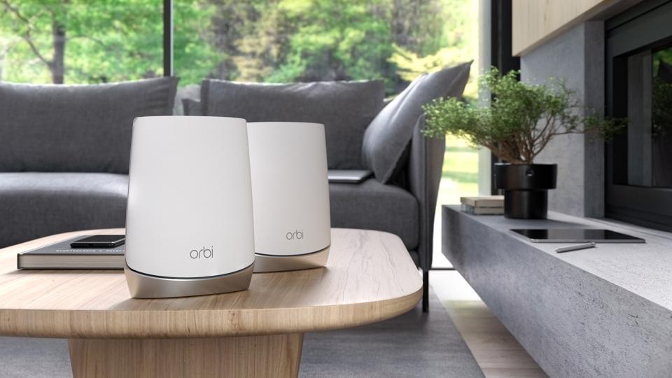 Netgear Orbi routers on a table