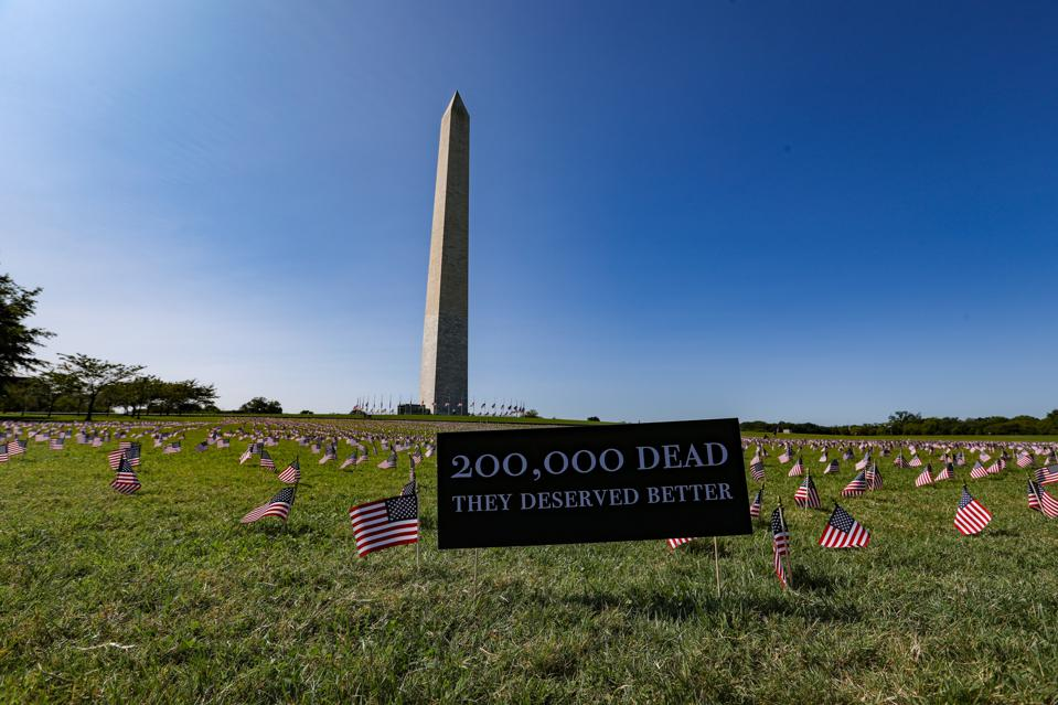 American flags placed on the National Mall for 200,000 American coronavirus victims