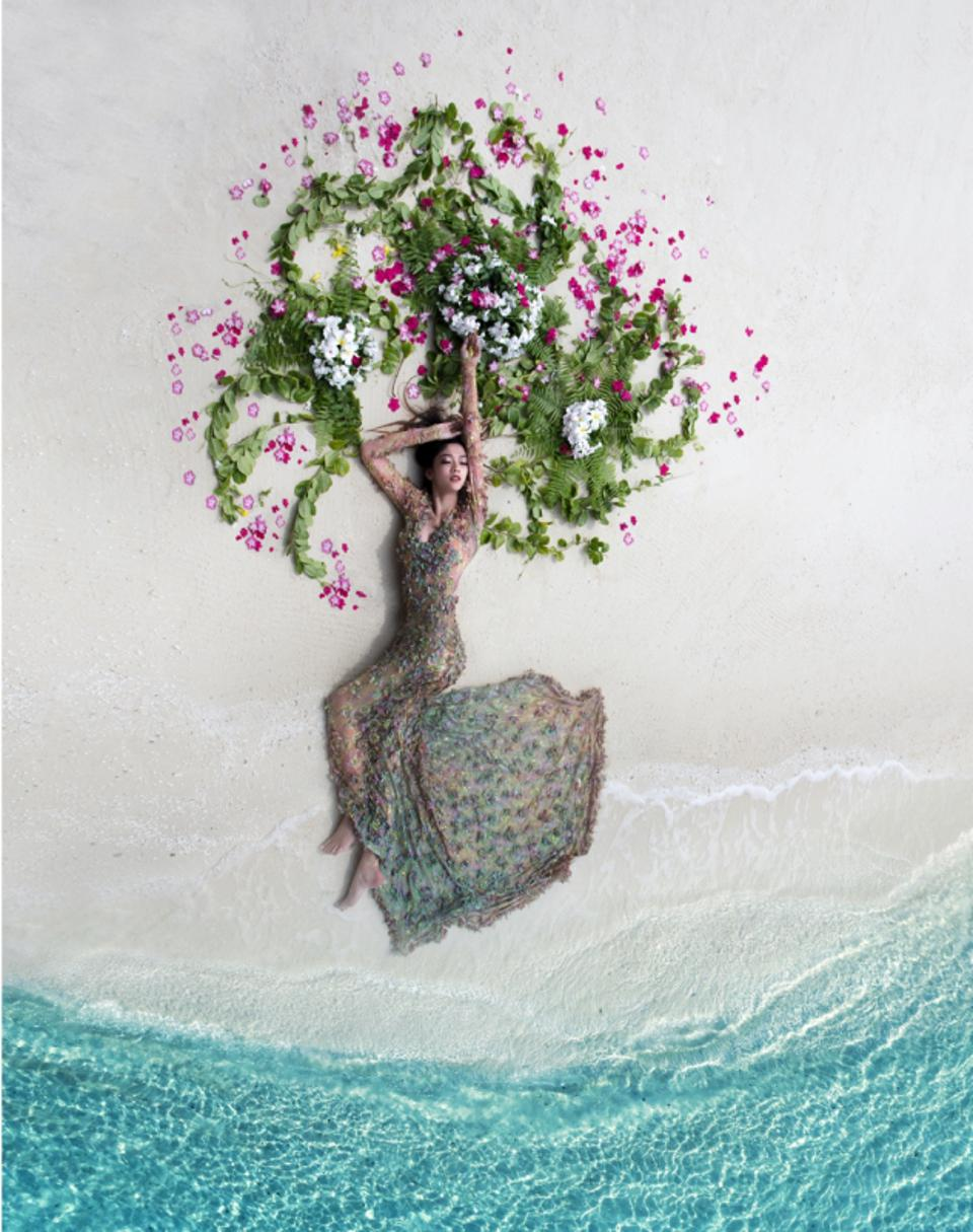 drone photo ;A bride at the beach surrounded by flowers