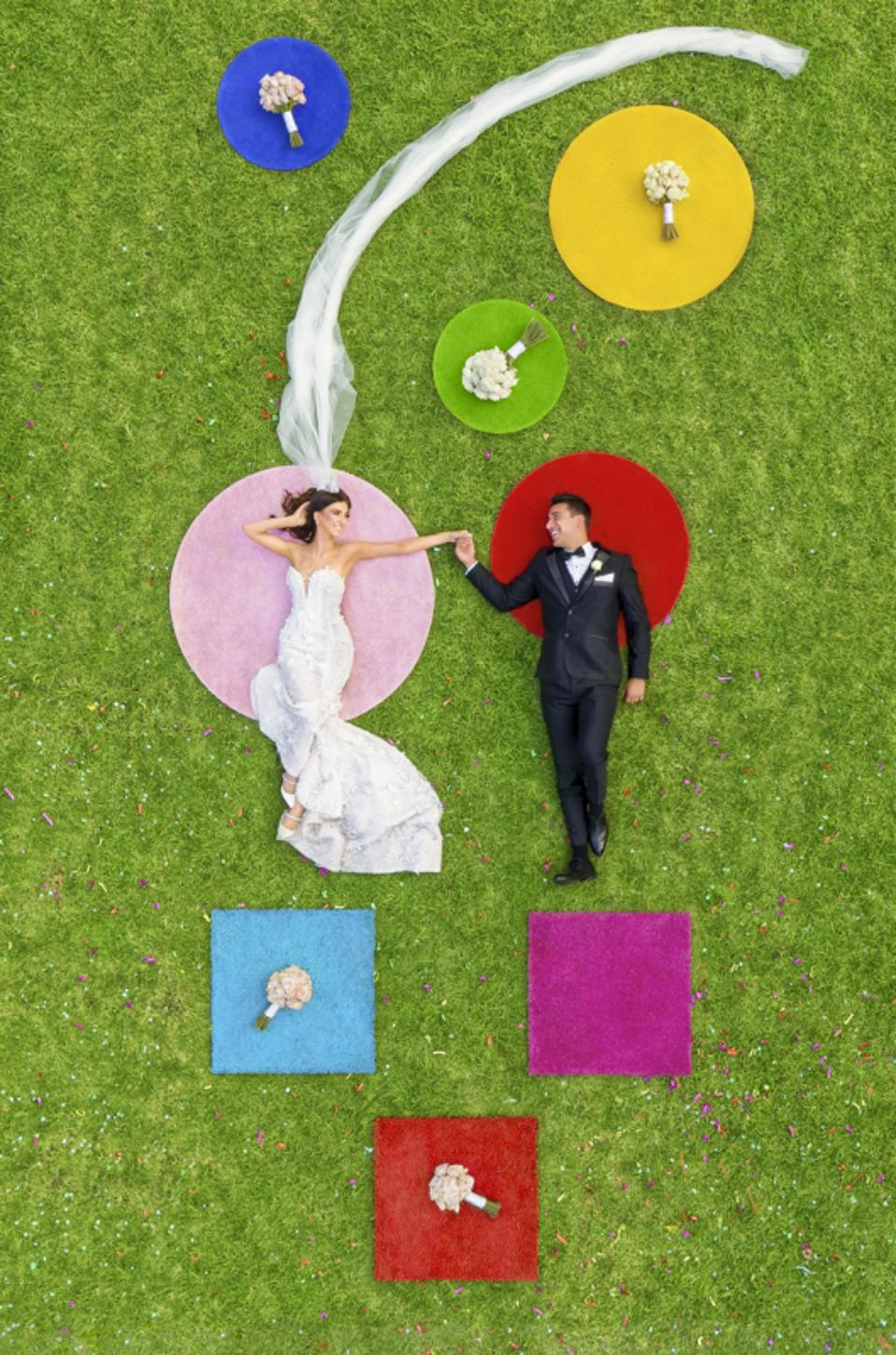 Siena prize winning drone photo of wedding couple in park.