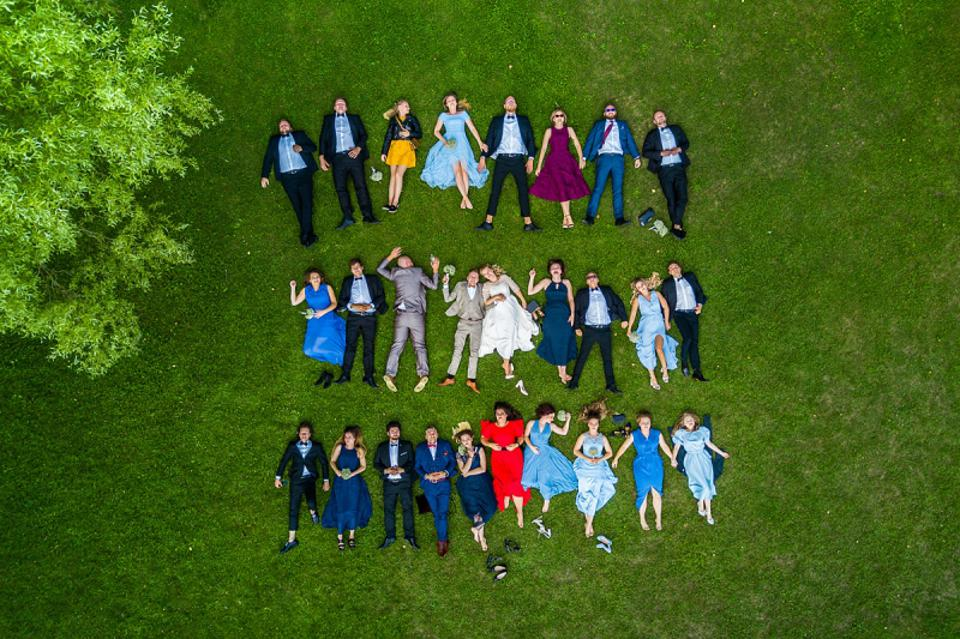 Prize winning  drone wedding photo of  couple with green background.