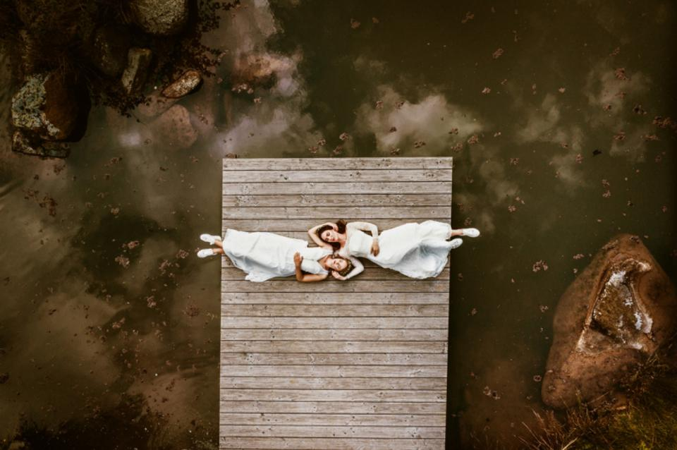 Prize winning photo of two brides taken with drone.