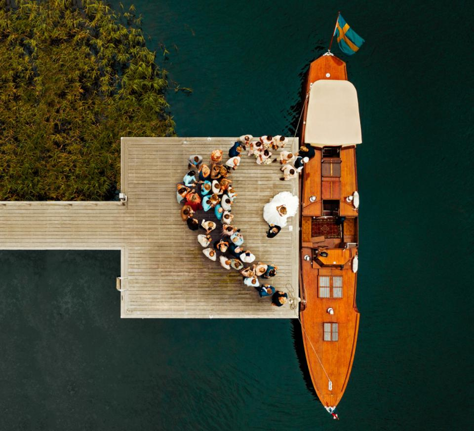 Prize winning photo of wedding couple and wedding party at a dock taken from above with drone