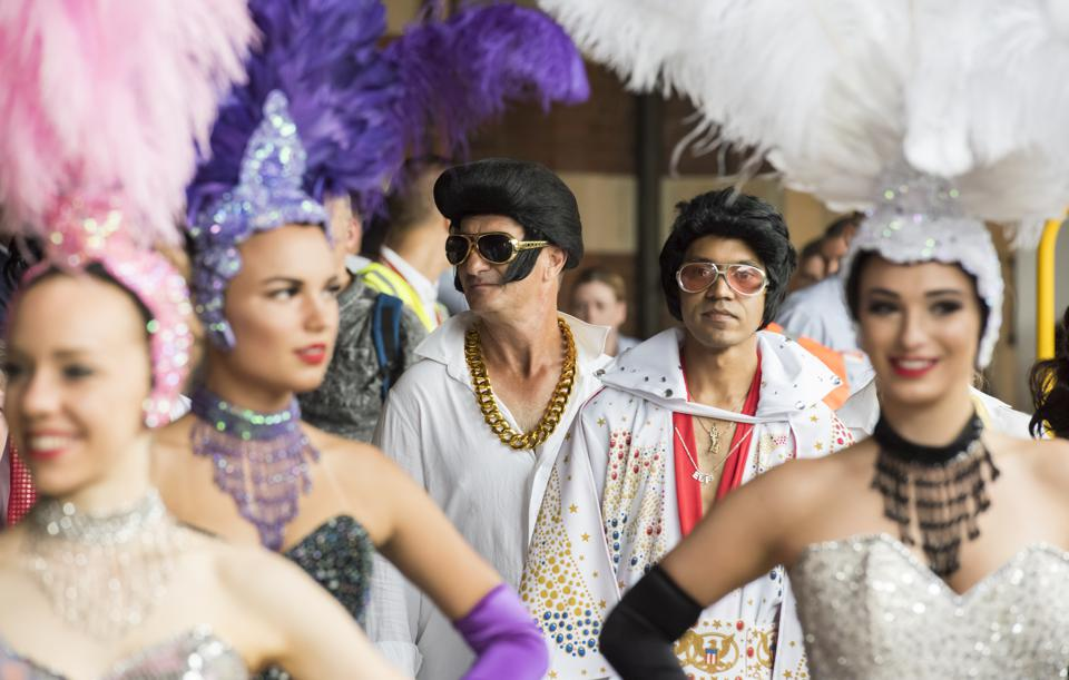 Elvis tribute artists and Vegas-style showgirls are waiting to board the ″ Elvis Express ″ train in Sydney.