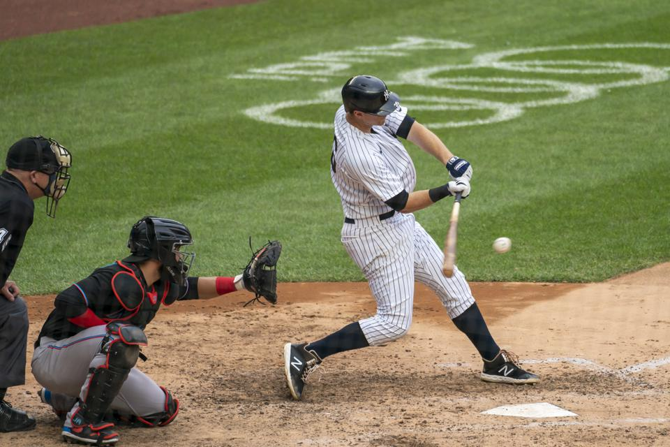 Right-handed hitter DJ LeMahieu makes contact with a pitch and hits a double.