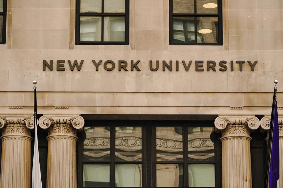 A view of New York University sign on the campus building...