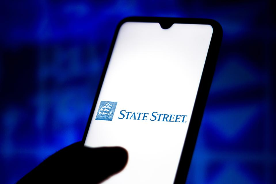 In this photo illustration the State Street Corporation logo...