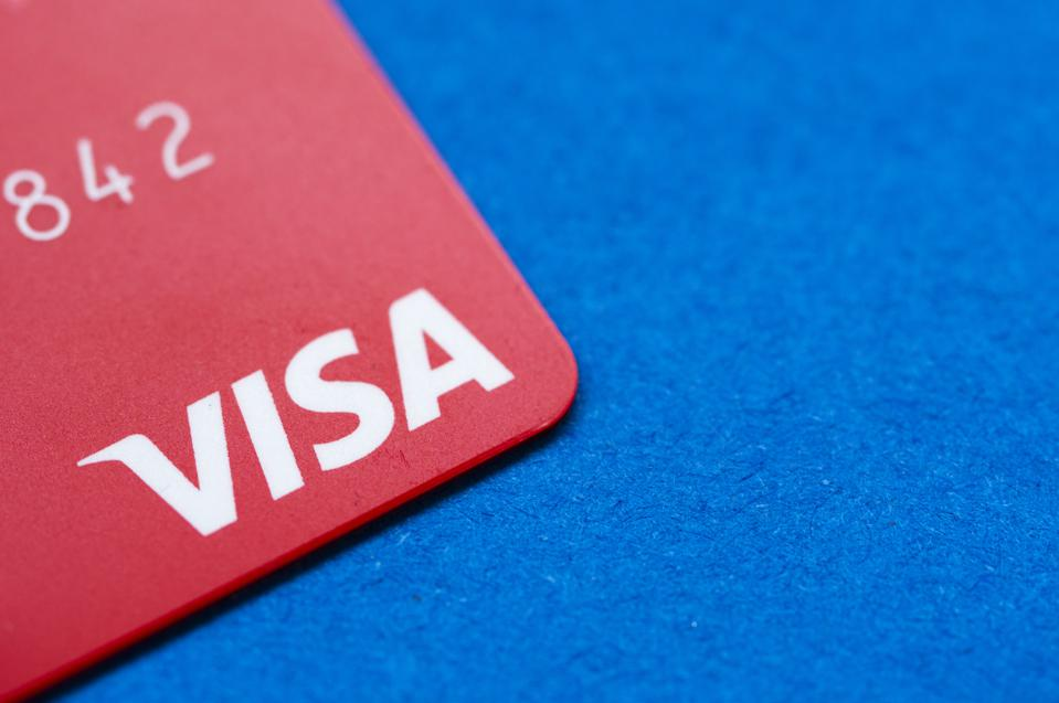 In this photo illustration a bank visa card seen on a dark...