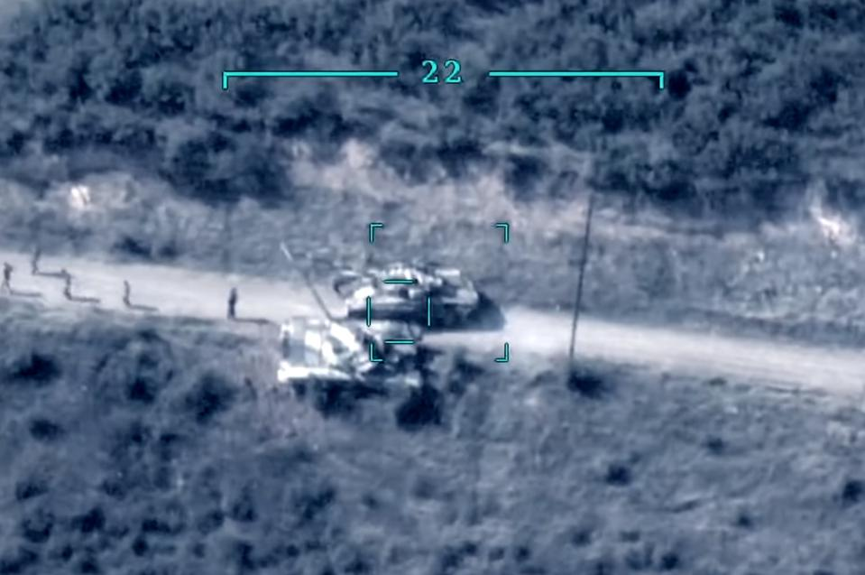 Two Armenian T-72 tanks in the targeting reticle of an armed drone.