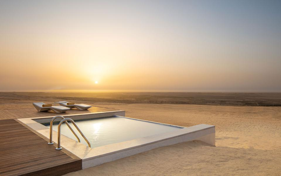 The villas at Anantara Tozeur in Tunisia have pools in the desert in the middle of nowhere