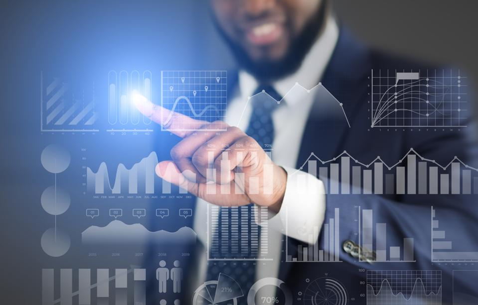 Businessman choosing with finger analytic diagram with data