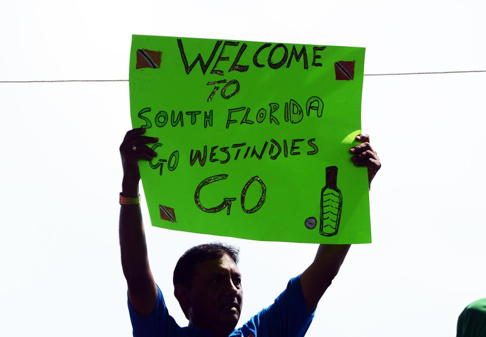 A cricket fan holds a placard during the