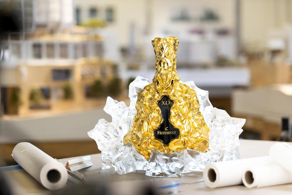 A decanter for cognac crafted with gold and glass.
