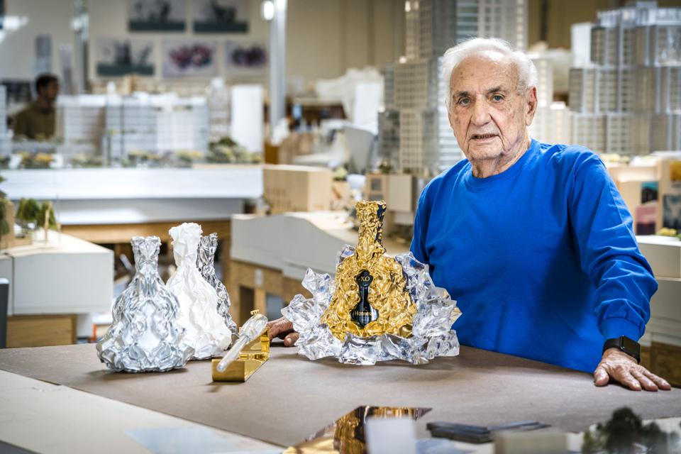 Gehry in his studio with the limited-edition Hennessy X.O. decanters he created.