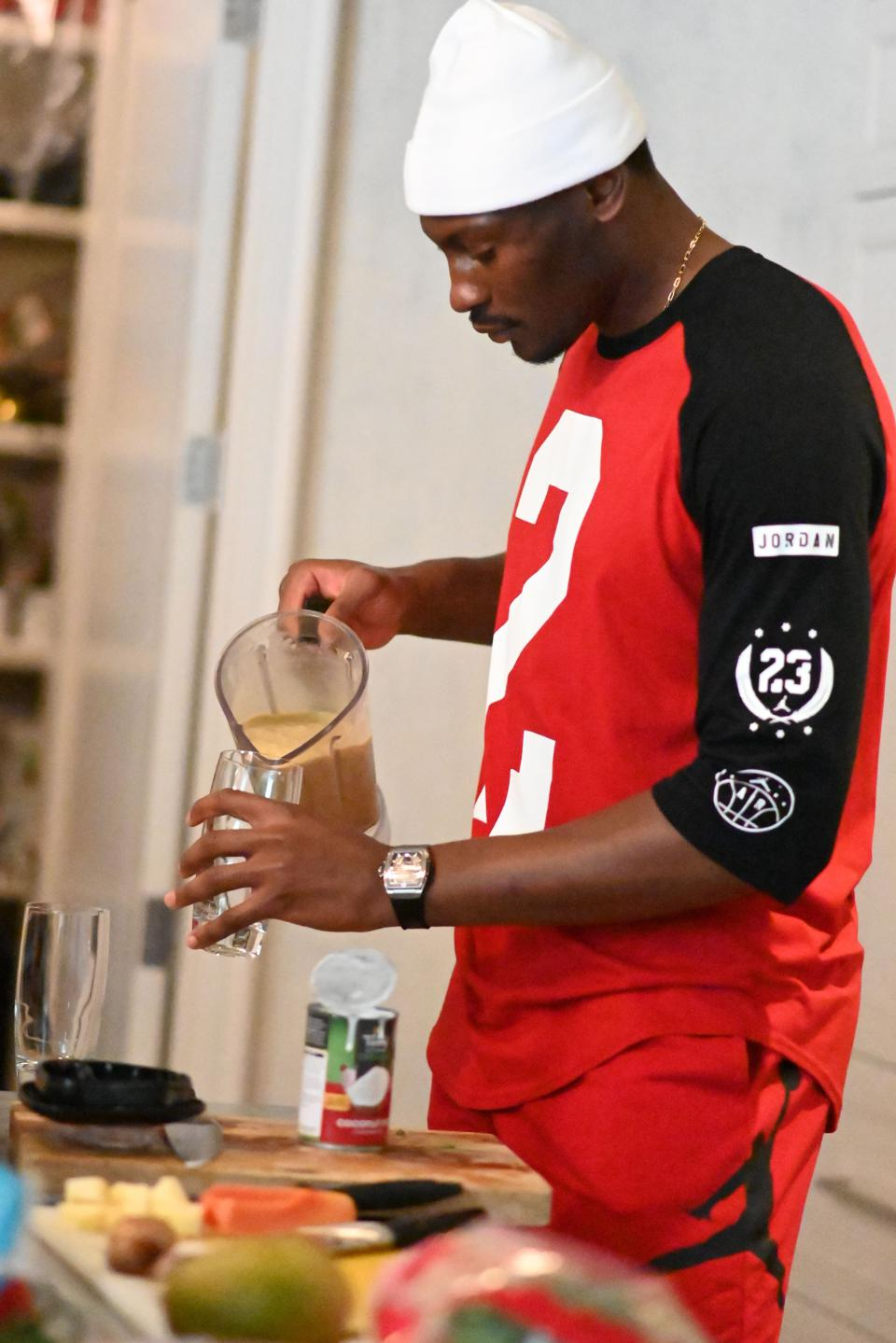 Bismack in the kitchen making a smoothie. Image courtesy of Bismack Biyombo / EAG Sports Management