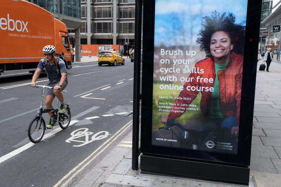 Cyclist And TFL Cycling Ad