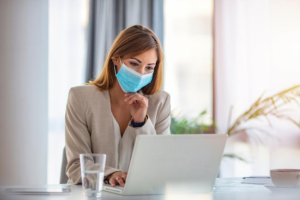 Woman working with mask.
