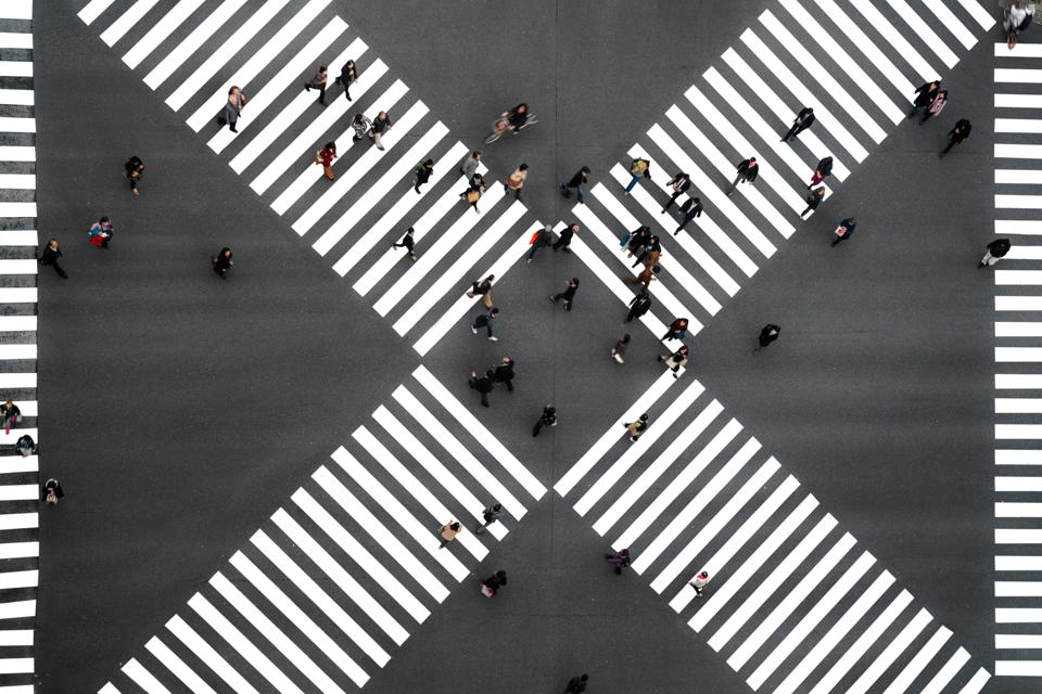 Many people crossing in Ginza pedestrian crosswalks, one of the busiest crosswalks in Tokyo and in the world at Japan.