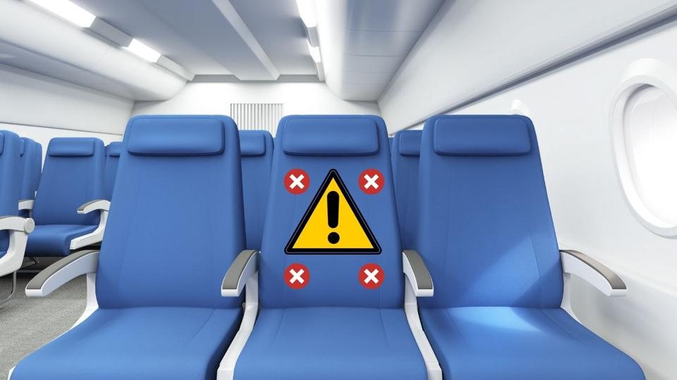 Three airplane seats with middle seat blocked.