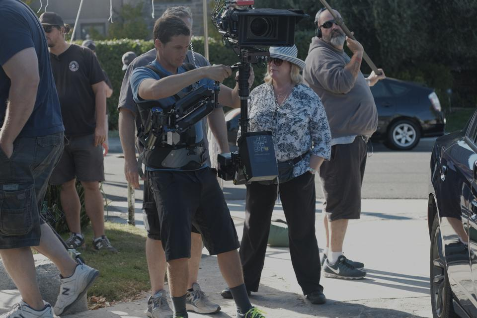 Acclaimed Hollywood director, Bethany Rooney, directing on the set of NCIS.