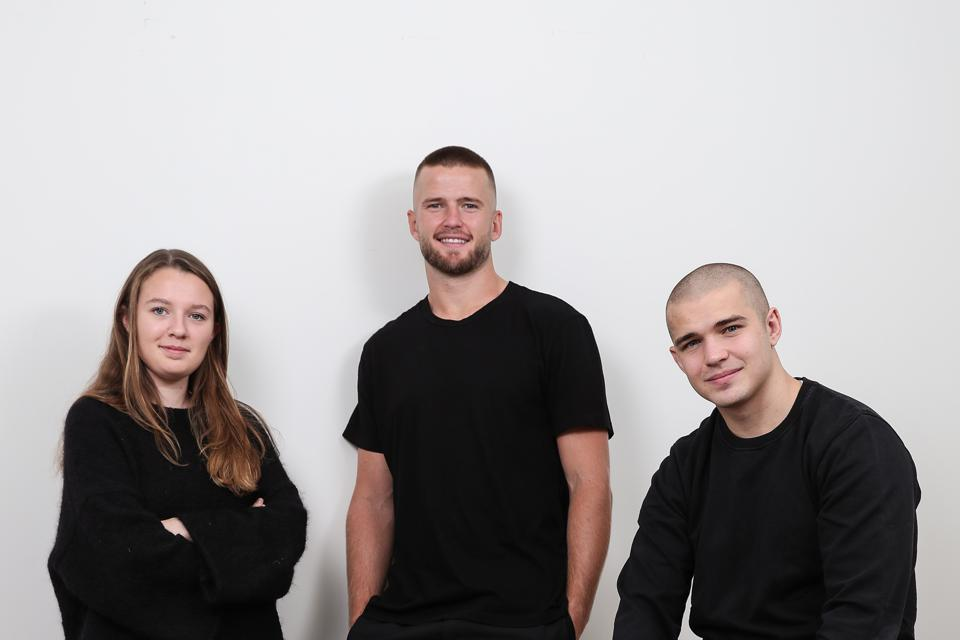 Eric Dier (center) stands with Spotals co-founders Zoe Connick (left) and Patrick Dier (right)