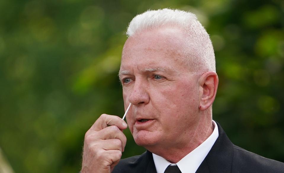 American Admiral Brett Giroir U.S. Assistant Secretary For Health with Covid testing swab