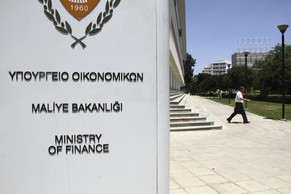 A man walks outside the Ministry of Fina