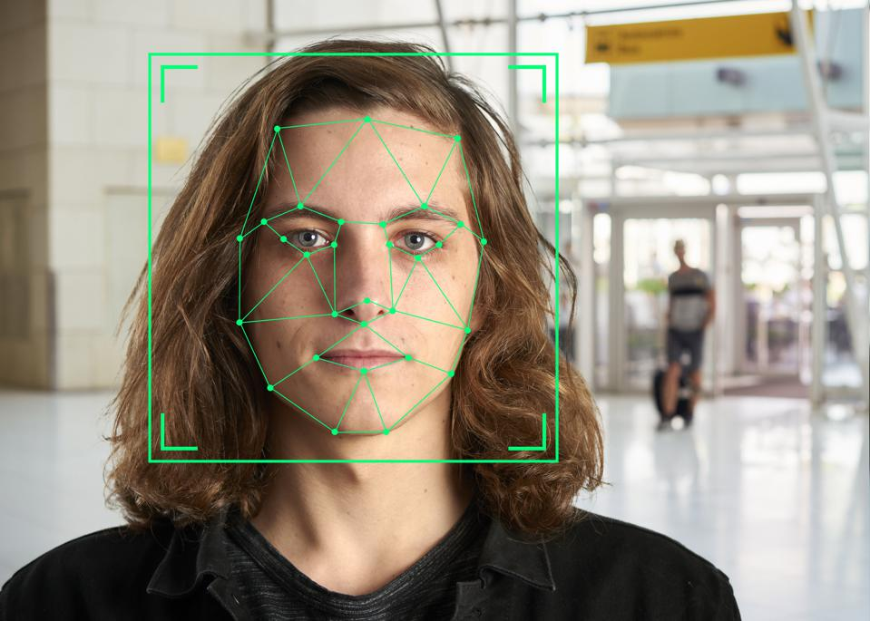 Face recognition markings on the face of a long-haired young man.