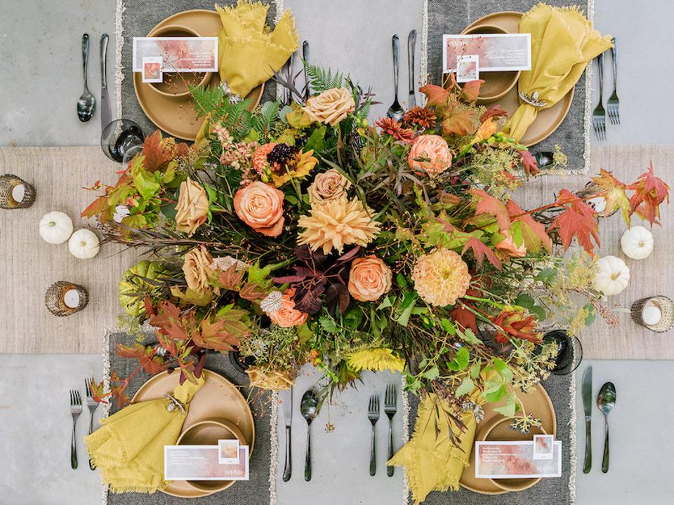 A tablescape and flower arrangement