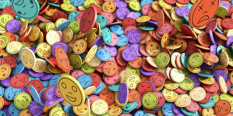 Multi-Coloured Emoji Emoticons Tokens In Mid-Air Falling Into Huge Pile