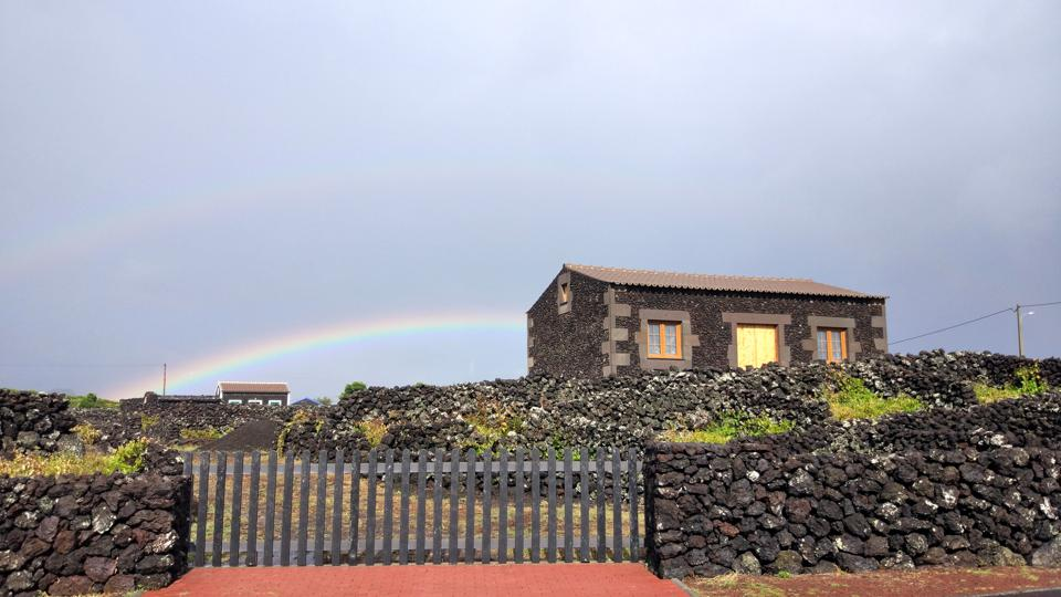 The weird weather in Terceira, in the Azores of Portugal, makes rainbows routine.