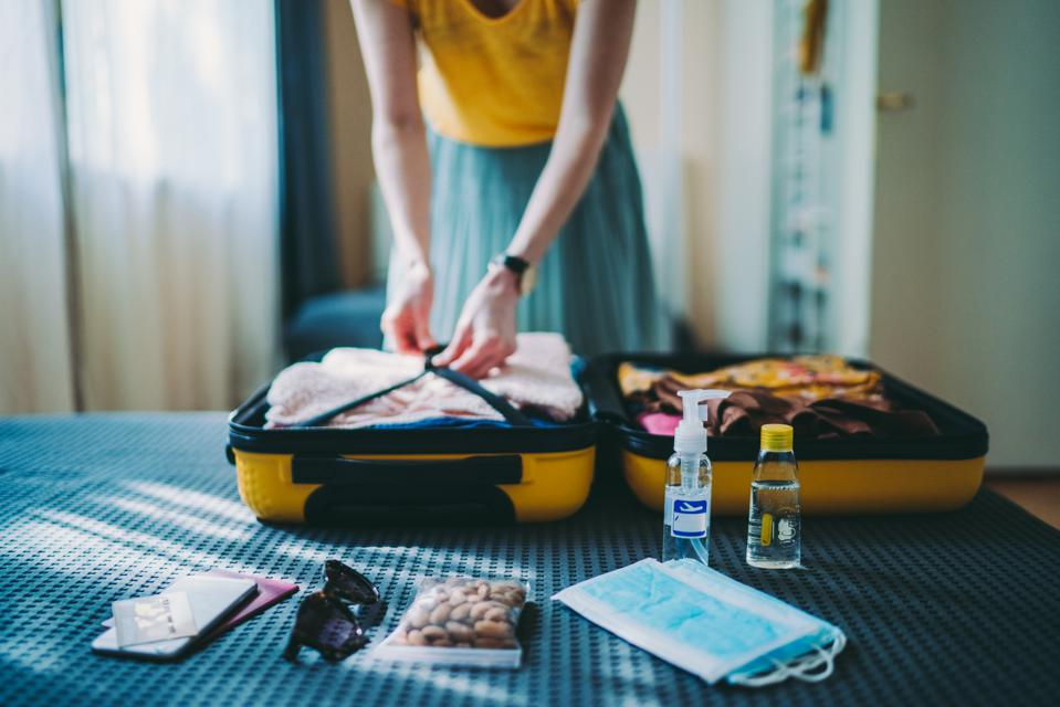 Suitcase packing for travel, COVID-19