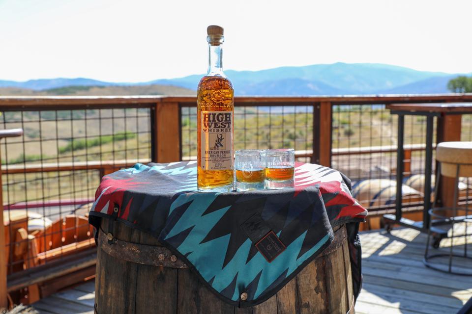 barrel of whiskey on a barrel outside