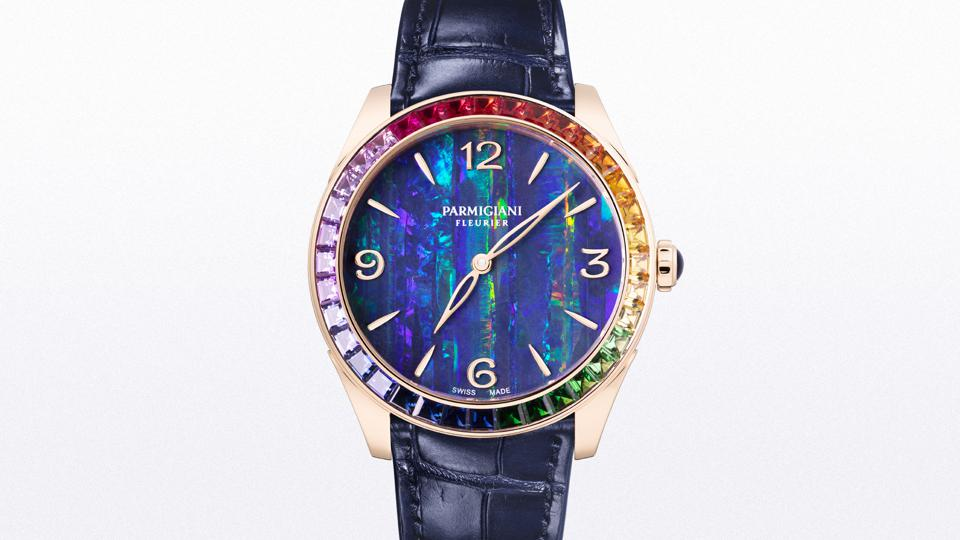The Tonda Métropolitaine Rose Gold Rainbow Opal watch has an opal dial and is surrounded by a rainbow of gemstones
