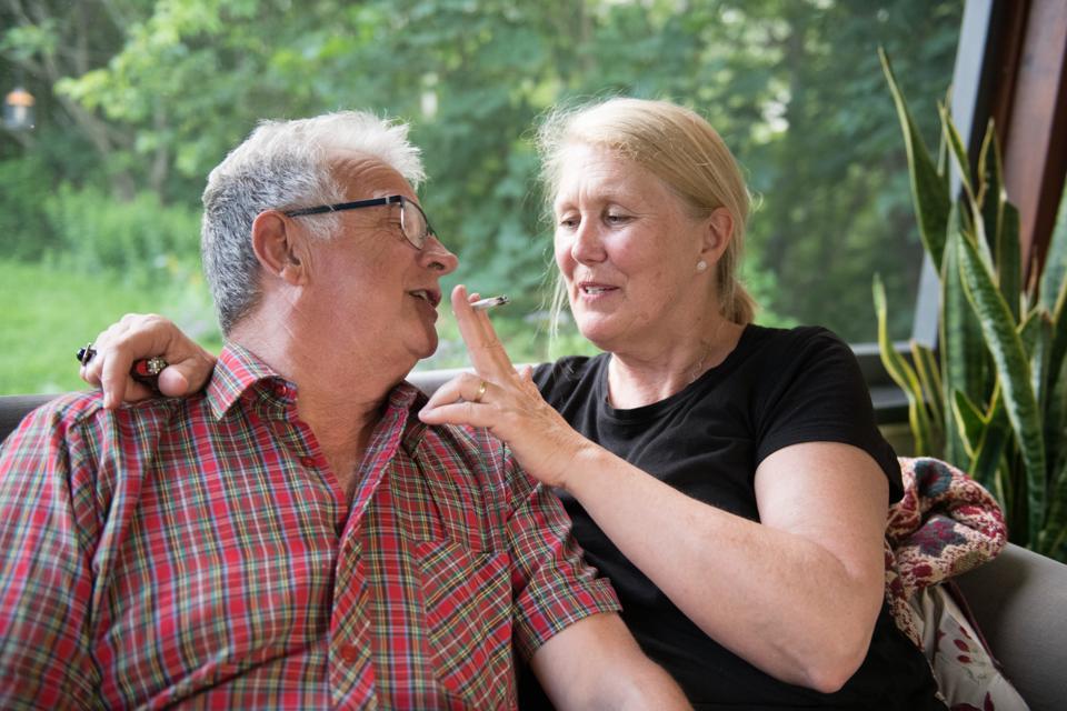 Senior retired couple enjoying marijuana