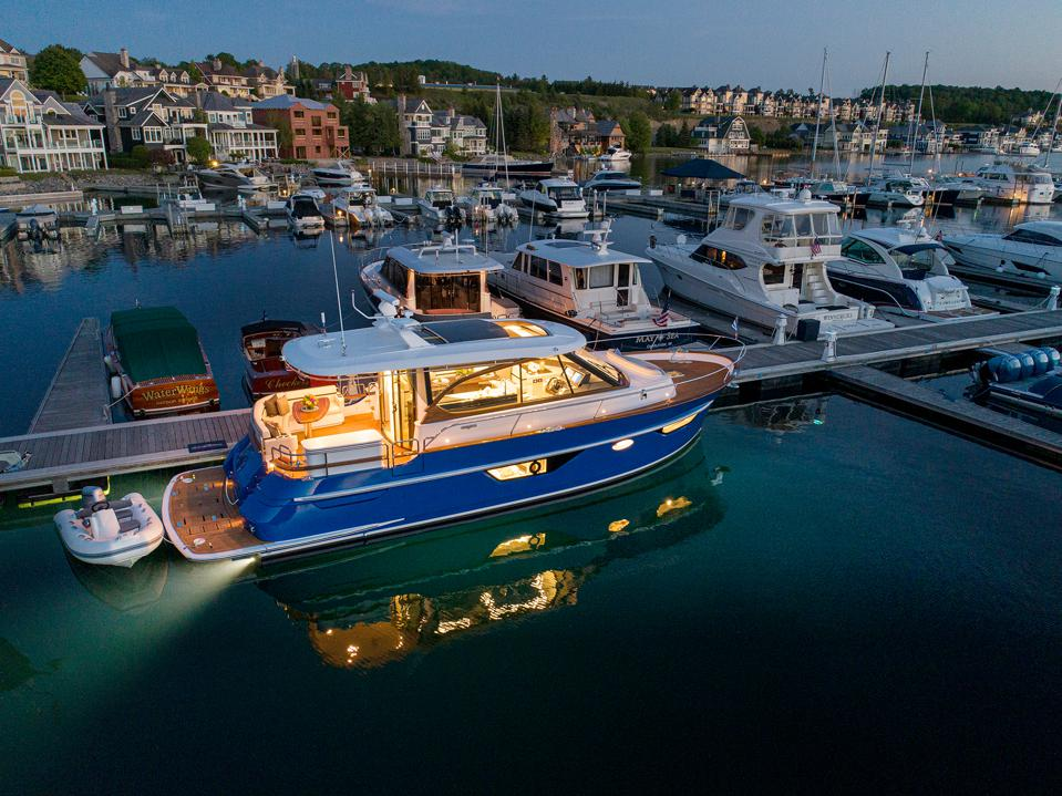 Interior-lit shot of a marina featuring the new Burger 50 Blue vessel