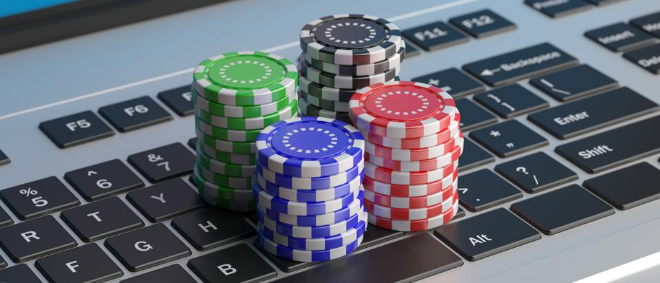 Casino poker chips stacks on a laptop keyboard. 3d illustration