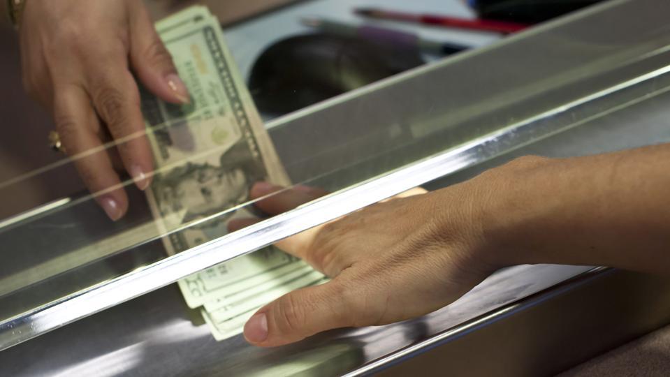 receiving cash from a bank teller