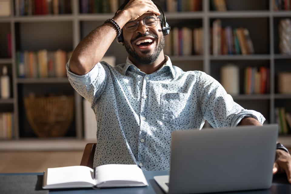 Man laughing during a fun virtual activity