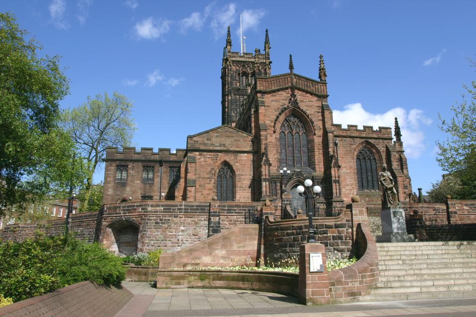 Lady Wulfrun statue and St Peter's Church, Wolverhampton, West Midlands
