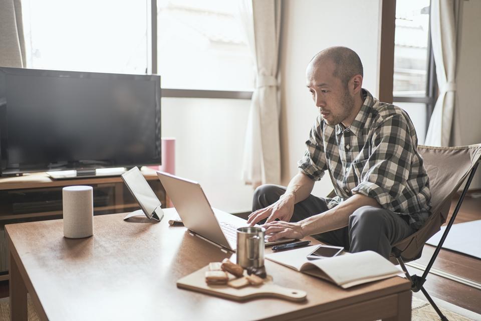 Asian male worker working from Home.