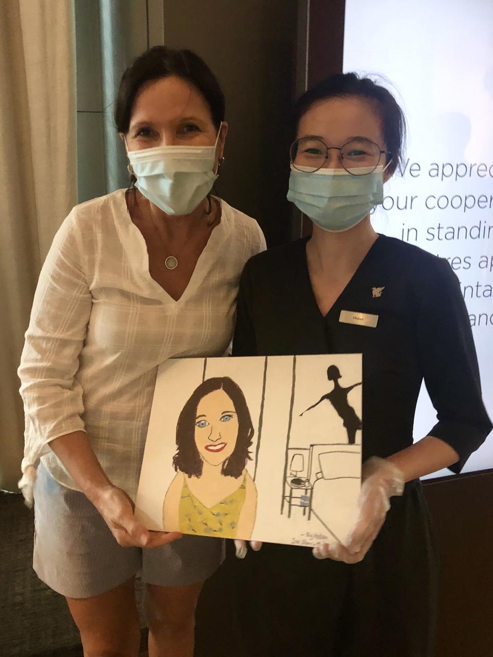 Margie Warrell receives a portrait from Marriott Associate. 26 September 2020.