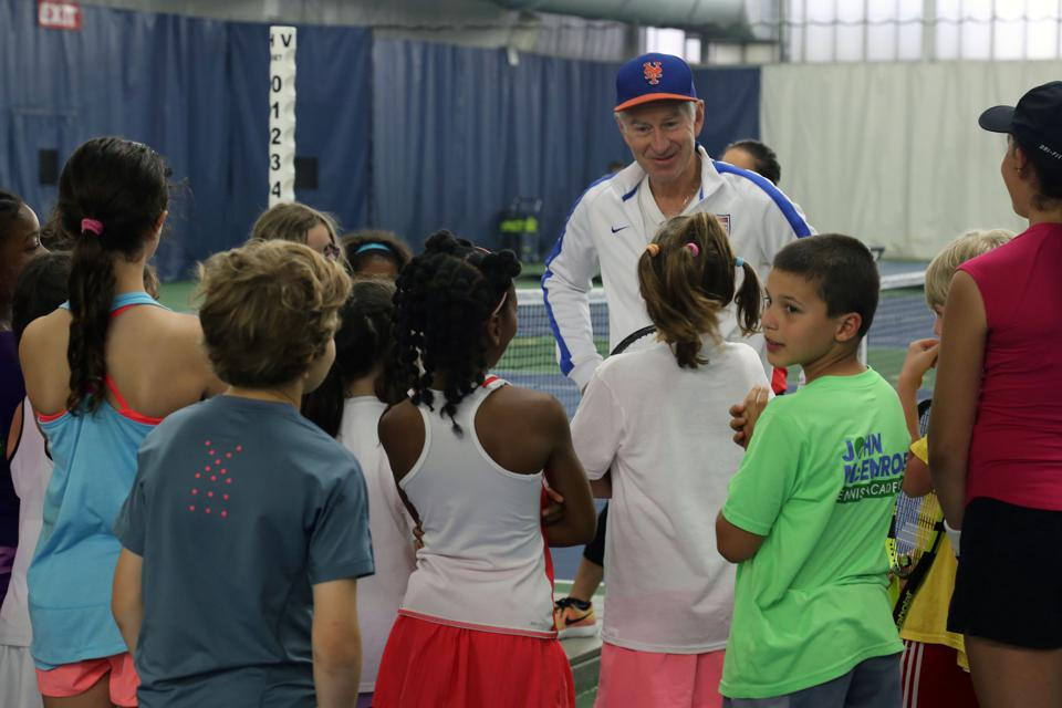 John McEnroe at his academy with students.