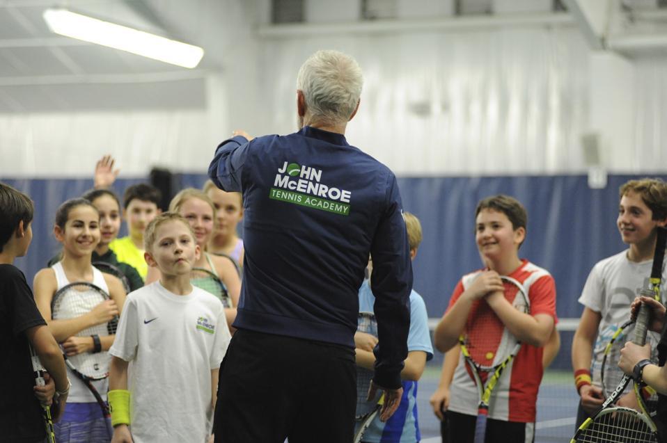 John McEnroe talking to students at his academy.