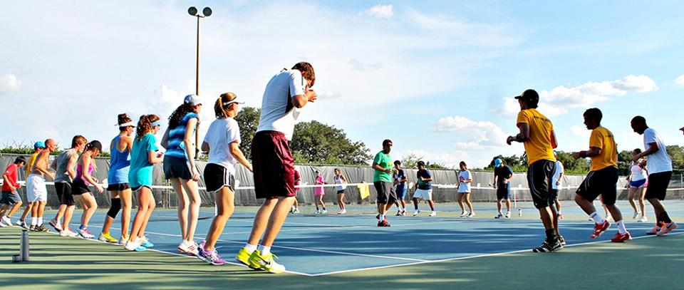 Juniors doing exercises at The John Newcombe Tennis Ranch.